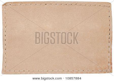 Etiqueta de los pantalones vaqueros de cuero en blanco sobre blanco