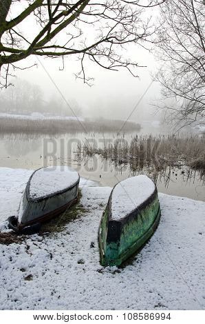 Two Upturned Boats On Winter Snow