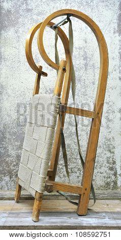 Retro wooden sledge on grunge background