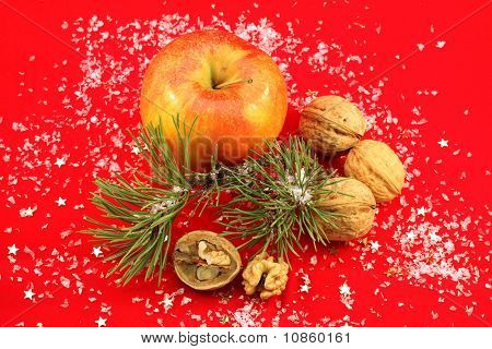 Christmas decoration with apple and walnuts