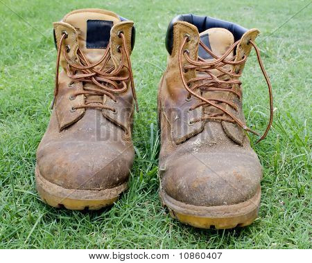 A Pair Of Tan Work Boots On Grass