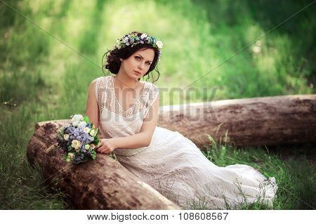 Beautiful bride in white dress in the garden