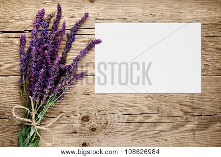 Bunch Of Salvia And Blank Greeting Card On Wooden Background