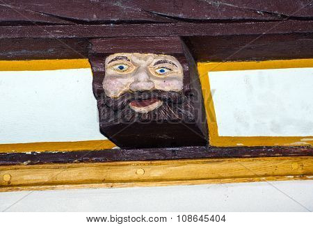 LIMBURG, GERMANY - JAN 4, 2012: wood carving and colored on balk timber of old framework houses