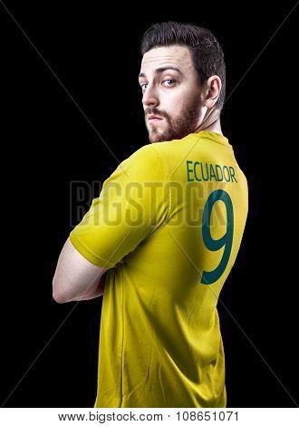 Ecuadorian soccer player player on black background