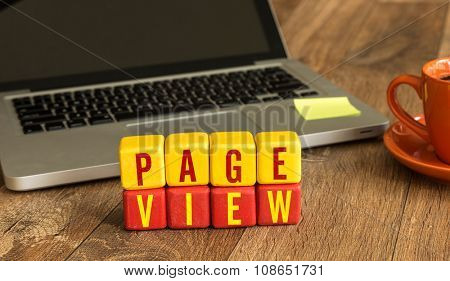 Page View written on a wooden cube in a office desk
