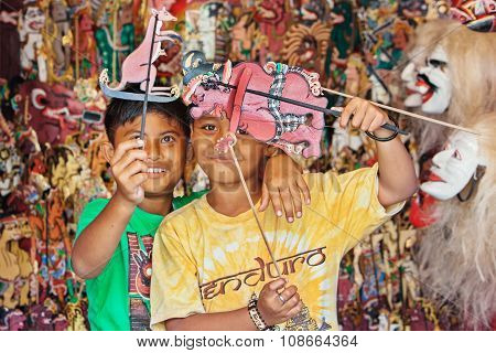 Smiley Balinese Children Play With Shadow Puppets