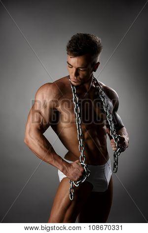 Male underwear model shows his muscular body