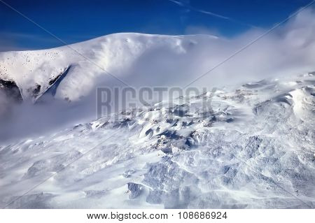 Winter Mountain Landscape. Snowstorm In Evening Light