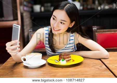 Girl In Cafe Shop Texting On Smartphone