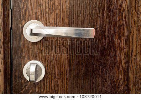 Shiny Knob On Brown Wooden Door