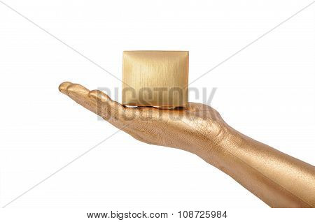 Man's golden hand holding box