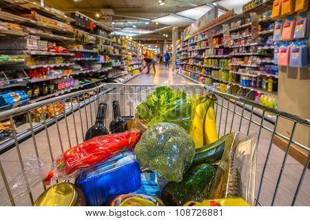 Supermarket Cart Filled Up With Products