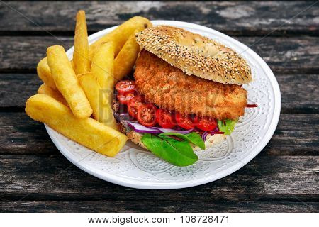 Home Made Chicken Burger With Fried Potatoes On Old Wooden Table
