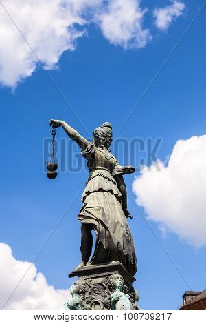 FRANKFURT, GERMANY - MAY 4, 2014: Statue of Lady Justice in front of the Romer in Frankfurt - Germany