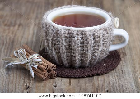 Cup Of Hot Spiced Tea In Cover - Warmer  .