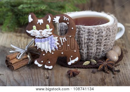 Cup Of Hot Spiced Tea  , Ginger Biscuits  And Some Spices  .