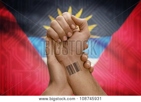 Barcode Id Number On Wrist Of Dark Skinned Person And National Flag On Background - Antigua And Barb