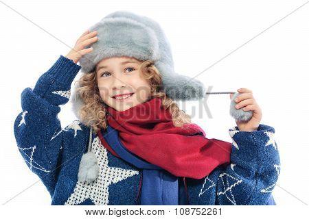 Girl wearing winter fur hat.