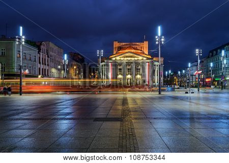Wyspianski Theatre On The Central Square Of The Katowice, And The Tram In The Evening.
