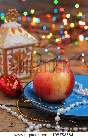 New Year's Still Life With Apple And A Garland.