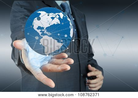 Businessman Working With New Modern Computer Show Social Network Structure And World As Concept