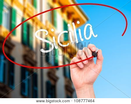 Man Hand writing Sicilia (Sicily In Italian) with black marker on visual screen.
