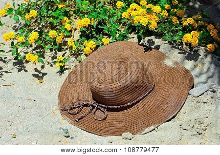 sand and straw hat