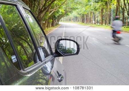 Car Standing On Wayside Of The Road With Green Tunel Forest Road