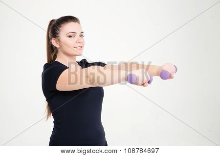 Portrait of a smiling fat woman workout with dumbbells isolated on a white background