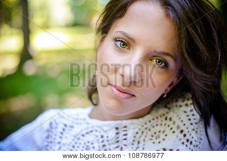 Head And Shoulder Shot Of A Pretty Woman At Park