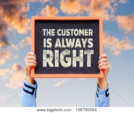 Hands are holding blackboard with word The customer is always right.