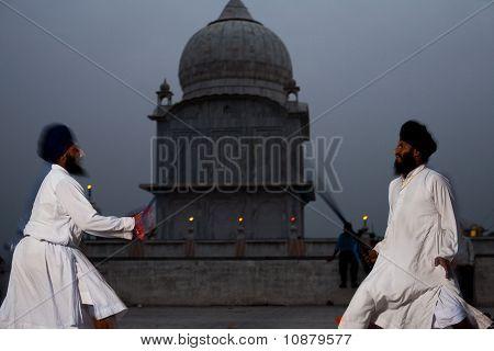 Sikh Men Duel Swords