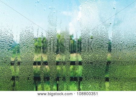 Droplets on glass in the morning with nature view poster