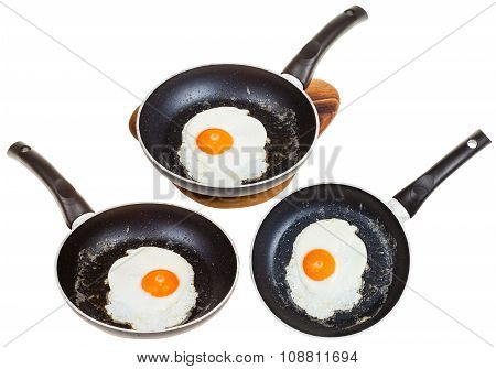 Set Of Frypans With One Fried Egg Isolated