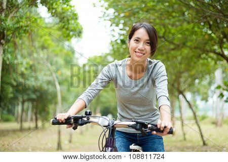Woman cycling at oudoor