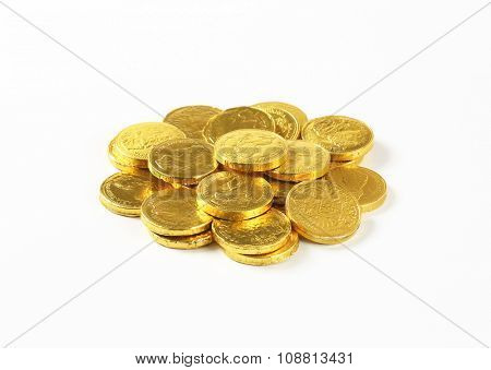 pile of chocolate coins on white background