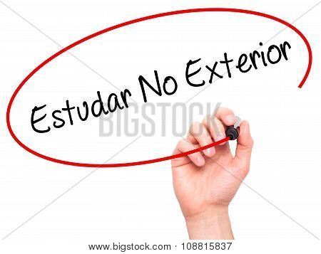 Man Hand writing Estudar No Exterior (Studying Abroad in Portuguese) with black marker on visual scr