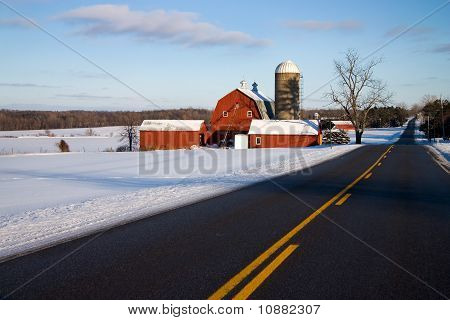Red Barn Along Road in Winter