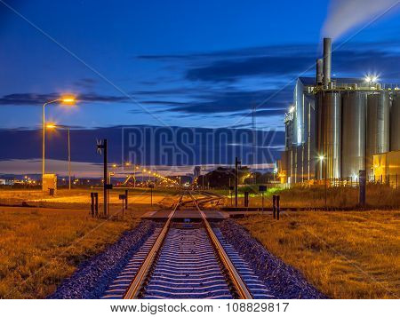 Railroad In Colorful Industrial Chemical Area