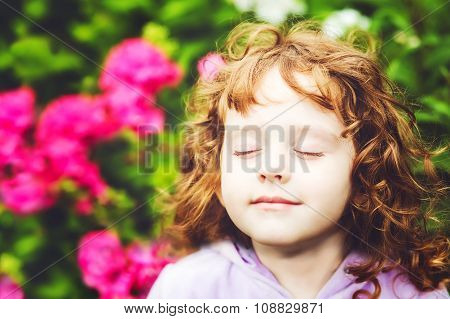 Beautiful Girl Closed Her Eyes And Breathes The Fresh Air In The Park.