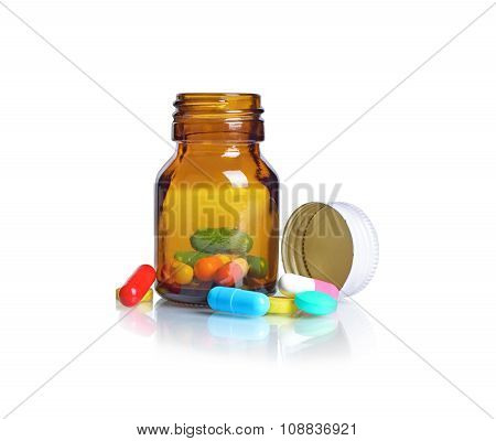 Pill Bottle Pills Spilling Out Of Pill Bottle Isolated On White