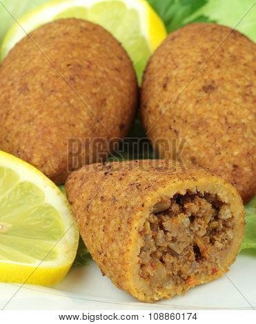 Turkish cuisine, bulgur coated meatballs - ( icli kofte ) close up image