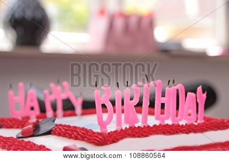 Quenched candles on a birthday cake close up image
