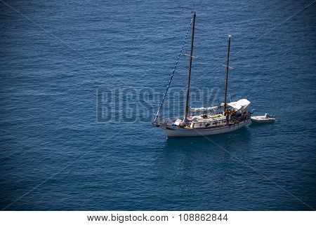 Sailing Boat in the middle of  blue sea