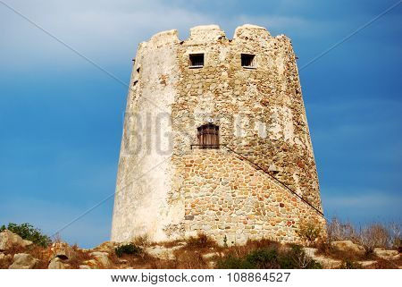 Spanish ancient tower in the coast with vivid blue sky back for tourism