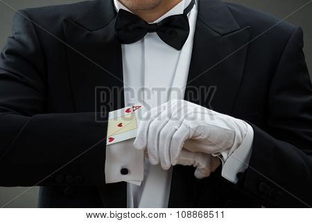 Magician Performing Magic Trick With Cards