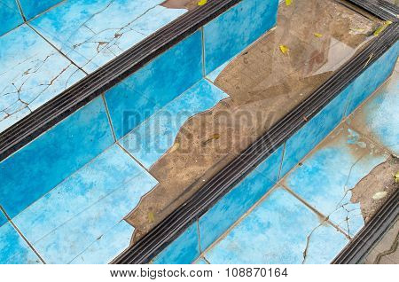 Top View Of The Stairs Close-up Of A Broken Blue Tiles