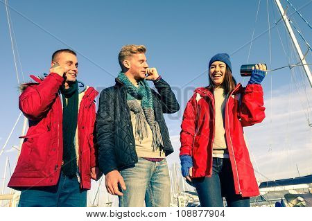 Sailing Trip Friends Having Fun Before Embark On Boat At Pier - Woman Holding Primitive Phone For Fu