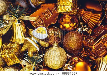 Christmas decorations box with stars, toys and ornaments. Golden baubles and ribbons
